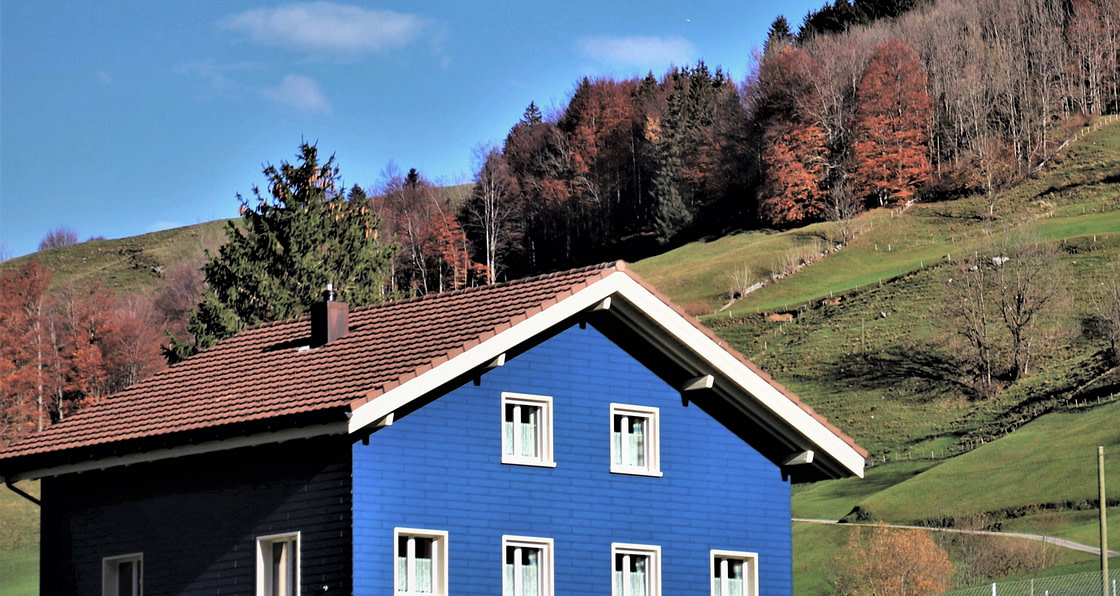 Blue house in the hills